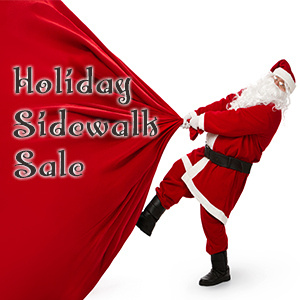Holiday Sidewalk Sale with santa and his bag